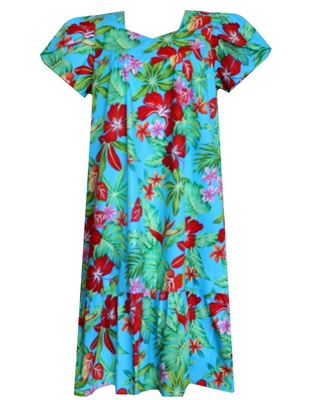 mud-calf muumuu dress with a vividly colored print containing hibiscus and bird of paradise flowers, surrounded by green foliage.