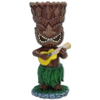 Miniature Ukulele Tiki that is spring loaded, playing a ukulele and wearing a hula skirt and sways near the skirt.