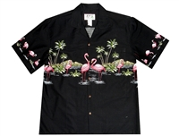 ​Black mens Aloha shirt with pink flamingos in a tropical setting with palm trees and volcano in the background.