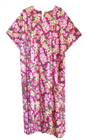 Womens pink colored mid-calf length Hawaiian print kaftan with pink, yellow flowers and green leaves