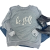 Be Still t shirt. Southern boutique wholesale graphic tee clothing by Pink Armadillos. Printed on our super soft Bella Canvas tees.