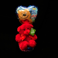 Various stuffed animals with a balloon and candy