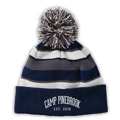 Knit beanie with pom. Embroidered with Camp Pinebrook logo.