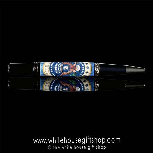 The White House custom wood pen is made up of 131 individually cut pieces. The 131 pieces are assembled one at a time like a jig saw puzzle, sanded with 14,000 grit followed by fifteen individual polishes and wax. From the White House Gift Shop.