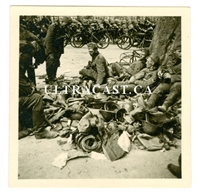 German Soldiers Resting on Pile of Captured Dutch Helmets and Equipment, Original WW2 Photo