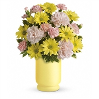 Give them sunny! Smiley carnations and happy daisies burst cheerfully from a yellow pedestal design vase. It's a bright arrangement-and a brilliant gift.