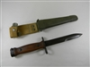 EARLY ITALIAN CARBINE BAYONET WITH WOOD HANDLE AND LEATHER SCABBARD.