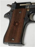 "STAR BM PISTOL WALNUT WOOD GRIPS WITH ""STAR"" LOGO."