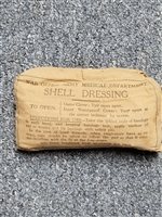 BRITISH WWII FIRST AID SHELL DRESSING.