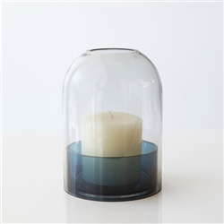 The Tota lantern from the Danish brand AYTM is made of colorful handmade glass dome and a base to place the candle on. The beautiful rounded shape creates a soft glow when lit.