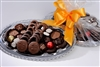 Artisan Chocolates beautifully arranged on an elegant silver platter. 