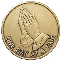 "Recovery Emporium, RecoveryShop - Bronze Inspiration Medallion - Front and Back images - Front features praying hands and the words ""One Day at a Time"" and the rear features the Serenity Prayer"