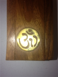 Traditional Wooden Stick Incense Burner with a brass inlay of the symbol OM