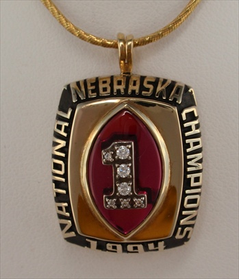 "1994 Nebraska Cornhuskers ""National Champions"" 10K Gold Football Pendant"