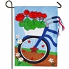 I love the red geranium filled basket and handle bar streamers of this adorable Patriotic Bicycle Garden Flag | LaBelle's General Store