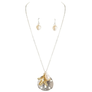 such a pretty piece!  Starfish and Sand Dollar Pendant with Pearl Charm | LaBelle's