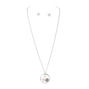 Love this artsy sealife necklace!  Starfish Necklace Set with Silver & Green Charms | LaBelle's
