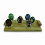 Holds up to 15 eggs for varnishing. It can also be used to melt wax from the egg in the oven. Instructions included.