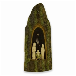 The artist takes a one inch vertical slab of tapered linden tree and carves a niche out of the bark side in order to fit a miniature Holy Family. Decorated with moss these rustic creches reflect the spiritual nature of the Polish countryside. No two crech