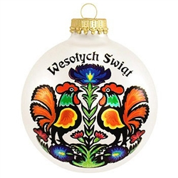 "Festive, colorful art complements the Polish Christmas greeting. Christmas customs of Poland are featured on the reverse side of this exclusive 3"" tall glass ornament.  Roosters are a classic Polish folk theme featured here in a gorgeous paper cut art des"
