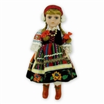 With Porcelain head, arms & legs, and hand made authentic dress, this is a beautiful doll! Costume is hand made so details will vary from doll to doll.