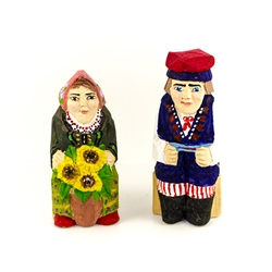 Hand carved and painted by folk artist Tadeusz Lesniak this unique pair is sitting with a vase of popular Sun Flowers!  Hand made so not two pairs are exactly alike.
