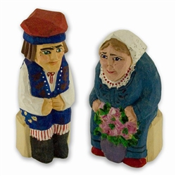 Hand carved and painted in Poland by folk artist Tadeusz Lesniak. Each pair is hand made so no two are exactly alike.