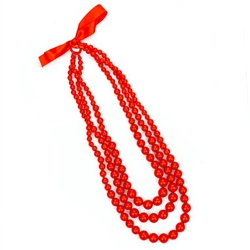 In the old days these red beads would have been made of real coral. Today new coral can no longer be imported so the Poles use a much less expensive substitute (polystyrene). These are made in Krakow for the Krakowianka dance costume