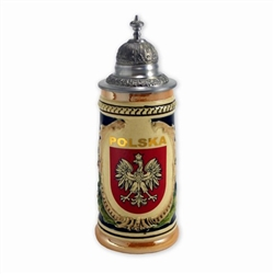 This beautiful stein is hand made and painted.  It features scenes from the Polish Tatra mountains and in the center, the Polish Eagle which is Poland's national emblem.  Please note that although the background color appears to be blue, it is actually da