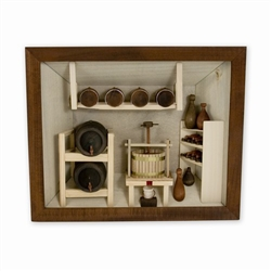 Poland has a long history of craftsmen working with wood in southern Poland. Their workshops produce beautiful hand made boxes, plates and carvings.  This shadow box is a look inside a traditional winery