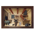 Poland has a long history of craftsmen working with wood in southern Poland. Their workshops produce beautiful hand made boxes, plates and carvings.  This shadow box is a look inside a traditional Polish blacksmith's workshop. Note the attention to detail