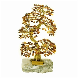 "The leaves of this bonsai style tree are made with real polished amber stones attached to branches and trunk of twisted brass wire. The tree sits atop a piece of the finest Polish marble called ""Marianna"". Brass tag is in English."