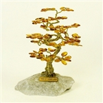 "The leaves of this bonsai style tree are made with real polished amber stones attached to branches and trunk of twisted brass wire.  Assorted Amber colors. The tree sits atop a piece of the finest Polish marble called ""Marianna""."
