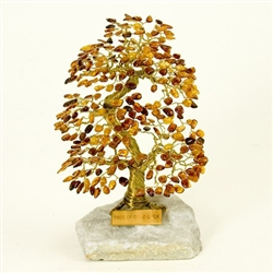 "The leaves of this bonsai style tree are made with real polished amber stones attached to branches and trunk of twisted brass wire.  The tree sits atop a piece of the finest Polish marble called ""Marianna"".  Hand made so no two are exactly alike."