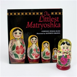 In a small shop in a snowy village in Russia, Nikolai the doll maker was carving his last matryoshka. From one piece of soft wood he shaped six nesting dolls, each one fitting inside the other. They all opened in the middle and were hollow inside, except