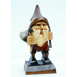 Hand carved in the mountain region of southern Poland this a Polish Troll with his mountain pick and load of gemsl.