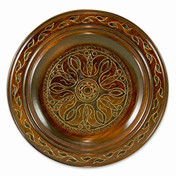 Polish wooden plates are made from Linden wood in the mountain region of southern Poland called Podhale. The plates are cut and shaped on a lathe by hand. The floral designs are burned into the wood before staining and varnishing. All the flowers are surr