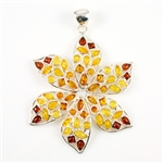 Hand made with Sterling Silver and genuine Baltic Amber in shades of dark honey, light honey, and light yellow.