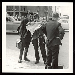Seeking Directions From the Milicja - Warsaw, 1968.  Historical Black and White Photo Postcard.