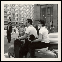 Couple on a motorcycle in downtown Warsaw in 1967. Historical Black and White Photo Postcard.