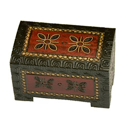 Footed base, curved top, elaborate decoration on top and all sides. Brass inlay, flat finish.