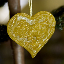 This pure beeswax heart is hand made by the residents of Dom Teczowy, a home for the mentally impaired located in Sopot, Poland.  Your purchase helps to support the Dom Teczowy Foundation that provides the care for the residents.