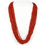 Beautiful faux coral multi-strand necklace with rich color perfect for wearing with a Polish costume. Imported from Poland but most likely made in India.