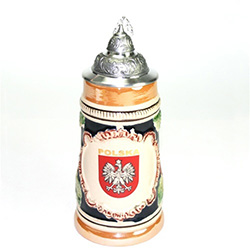 This is a very handsome beer stein! What a great gift for any occasion! The Polish Eagle is proudly displayed in a crest with POLSKA (POLAND) in gold letters.  This beautiful stein is hand made and painted.  It also features scenes from the Polish Tatra m