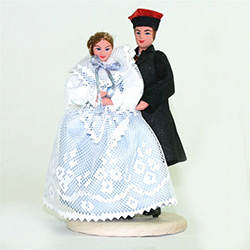 The Zywiec couple come from the town with the same name in the mountain region of southern Poland. The woman's dress comes in a variety of colors. Blue is in the picture.