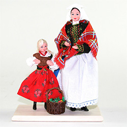 The Polish Easter tradition of taking your Easter basket to church for the blessing of the food is depicted here.  Mother and daughter are in their traditional Krakow costumes bearing their filled Easter basket as well as a bread baked in the shape of the