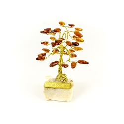 "The leaves of this bonsai style tree are made with real polished amber stones attached to branches and trunk of twisted brass wire. The tree sits atop a piece of the finest Polish marble called ""Marianna"". Brass tags are available in either English or Pol"