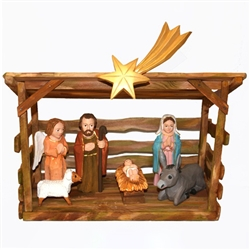 The Holy Family and in particular the Nativity is a popular theme in Polish folk art. Mr Wolinski's carvings are very colorful and precise. They are all separate and can be moved as you like.