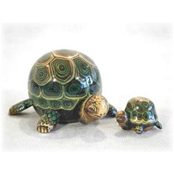 Here is a cute pair of happy-go-lucky nesting turtles.  These animals have been a best seller for ages.  Hand painted in St. Petersburg Russia.