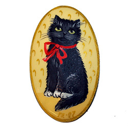 Beautiful handmade Russian lacquerware brooch with a handpainted black cat against a tan background.